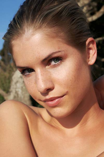Her nubile beauty emanates from the coastal surrounding