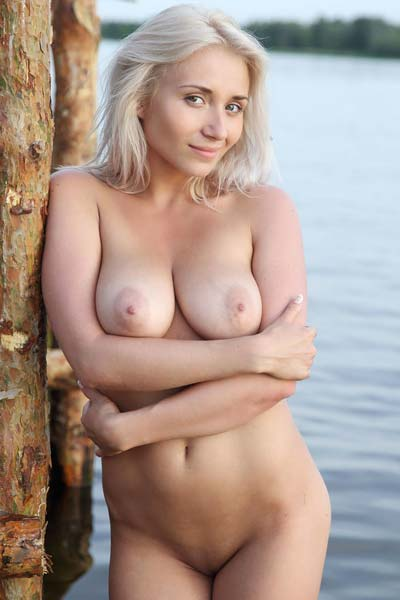 Busty blonde Isabella D holds nothing back