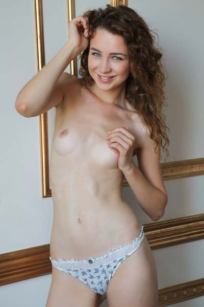 Young skinny brunette Lilu M poses nude for you