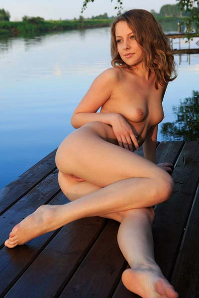 Sensual striptease on the docks by perky Nikia A