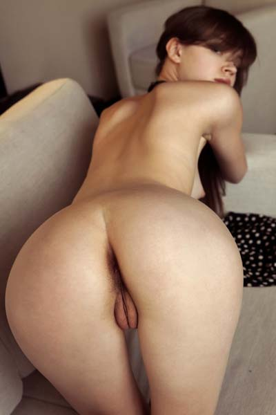 Perky brunette Kitana A exposes her assets on the sofa