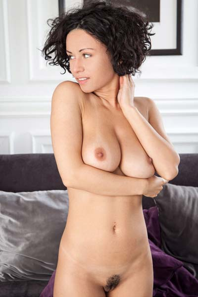 Pammie Lee exposes her big round breasts sensually