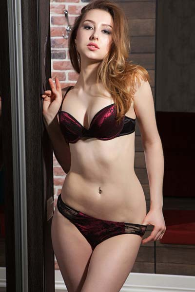 Slender brunette Ginger Frost takes off her bra and panties