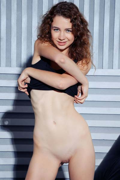 Wild and sexy Lilu M bares her skinny body