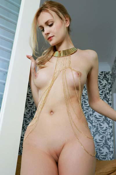 Beautiful blonde Tais poses nude for the camera