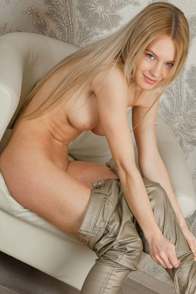 Xena lays down naked on the couch
