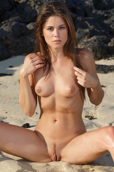 Caprice A gets nasty at the beach as she poses naked for you