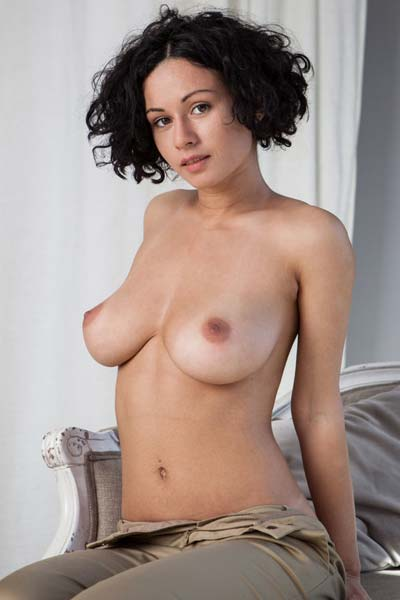 Pammie Lee loves to show you her enticing curves on the camera