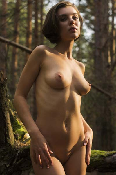 Dakota A gets kinky in the forest as she bares her sweet pussy and busty ass on the camera