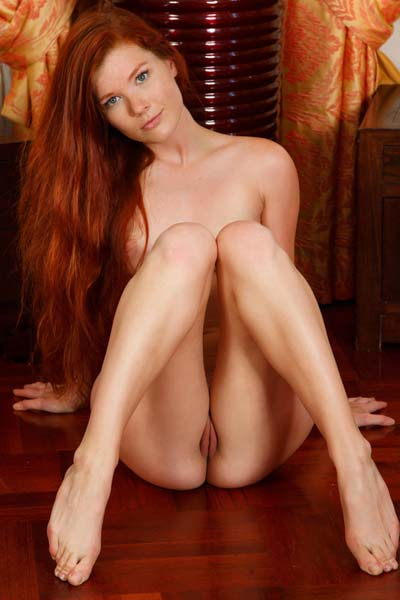 Mia Sollis lies naked on the floor showing off her sweet and sexy body