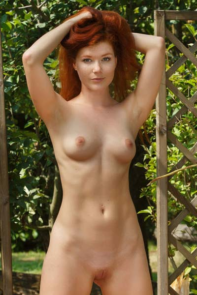 Mia Sollis poses naked outdoors as she reveals her sweet pussy and perky tits