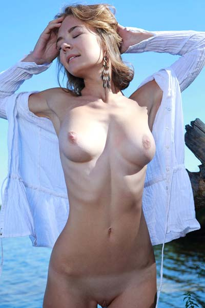 Selina gets super horny as she playfully bares her beautiful curves on the camera