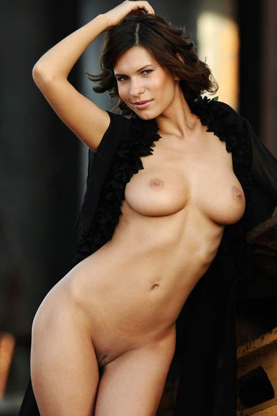 Ravishing brunette Suzanna A presents her gloriously large breasts and slim body