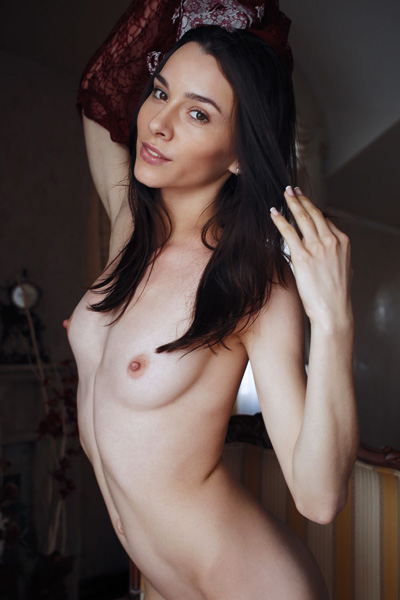 Astonishing dark haired babe Adel Morel poses in many erotic positions and bares her peachy ass