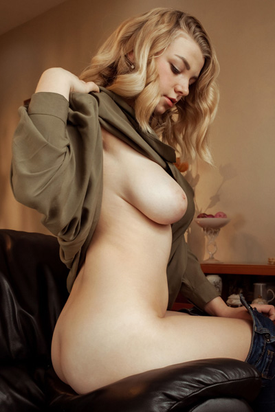 Beautiful busty blonde Daniel Sea poses naked on the leather sofa and flaunts all she has