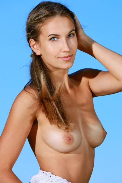 Magnificent brunette angel Milenia poses in the nature and bares her perfectly tanned body