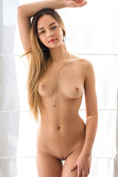 Amazing petite doll shows off her youthfull naked boobs and her peachy butt