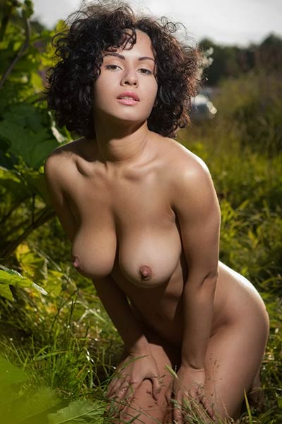 Top class babe with perfect tanned body shows off her wild sexiness as she poses in nature
