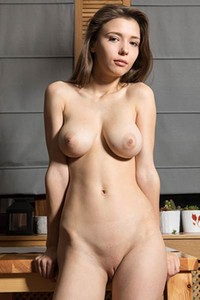 She always looks hot especially when she takes off her top and frees her curvy heavy breasts