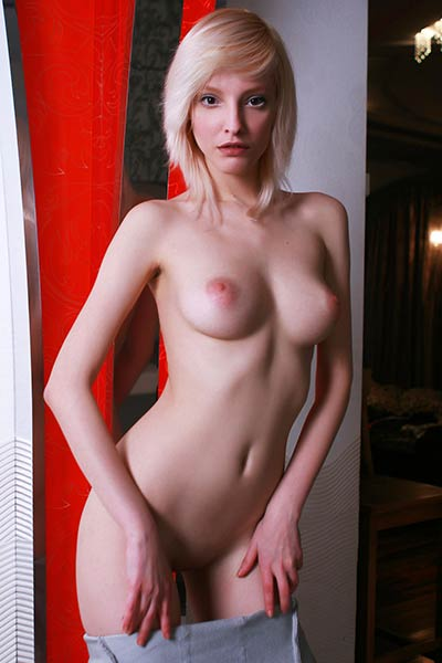 Enjoy watching cute blonde girl taking off her grey dress and posing all naked