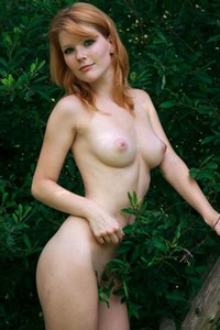 Mia Sollis presents her perfect pale body as she poses naked on the bird watching tower