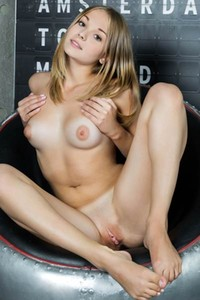 Beautiful blonde doll Jeff Milton posing all naked on the bed