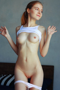 Shayla is in her bedroom stripping and posing in nude on the bed