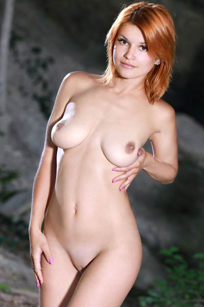 Violla A offers her delicious shaved pussy peeking out from between gorgeous buns