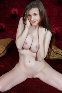 Emily Bloom slowly strips off her sexy lingerie revealing her astonishing attributes