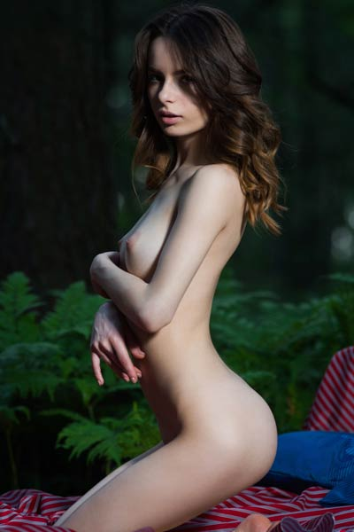 Debora A is in the woods taking her clothes off and posing in nude