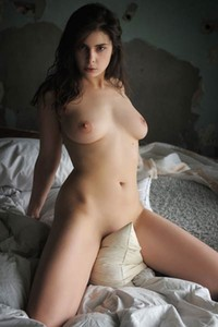 Tempting brunette doll showcasing her juicy natural boobs and hot ass