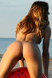 Kaleesy is on the beach having fun without any clothes on her sexy body