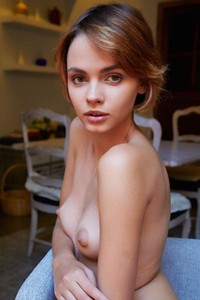 Sexy cutie Lilit A bares her gorgeous body on the chair