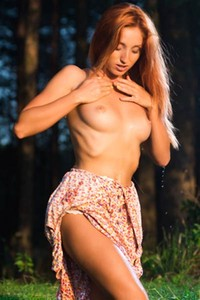 Sexy chick with hot body stripping and teasing naked in the woods