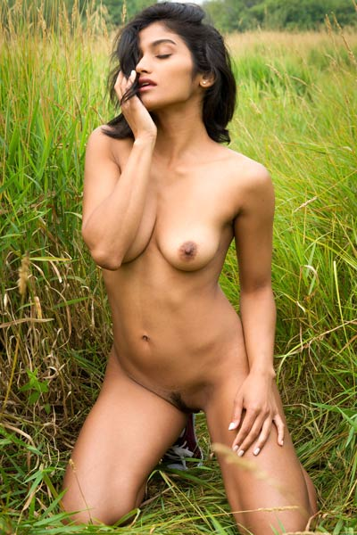 Exotic dark haired babe exposes her perfect tanned body in nature