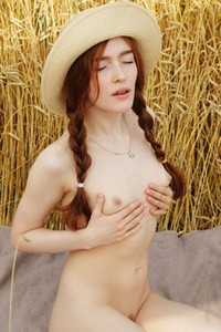 Luscious redhead doll exposes her hot pale body in nature
