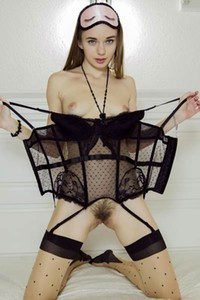 Girl in sexy black stockings Milena D exposing her hairy muff
