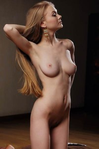 Blonde bombshell Nancy A strips naked and teases with her magnificent body and smooth tits