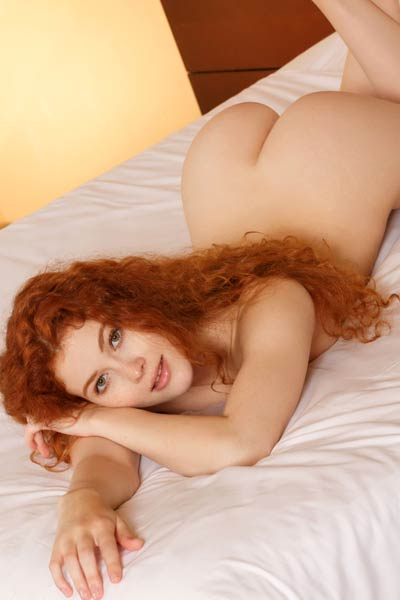 Adel C cute redhead babe slips out of her underwear flashing with her hot curves