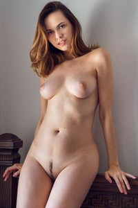 Adorable young babe Nasita poses naked and exposes her amazing female body