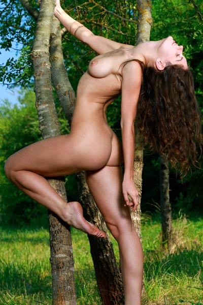Smoking hot Yasmina takes off her red bodysuit outdoor showing off her perfectly shaped body