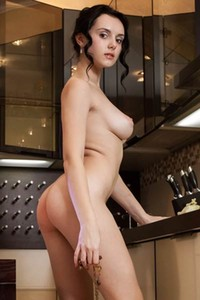 Anatali babe with nice natural boobs ass and pussy flashing with her naked body in the kitchen