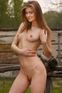 Dazzling young babe gives us a glint of her love holes as she poses naked outdoor