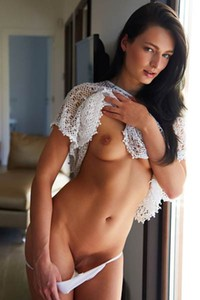 Charming and cute dame exposes her magnificent body