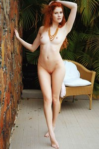 Redhead vixen with astonishing body gently takes off her yoga pants and exposes her amazing bum