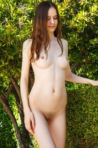 All natural babe Eiby Shine sensually poses on and teases with her pale body