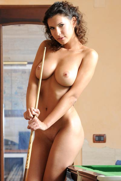 A confident Suzanna A poses naked by the snooker table with a teasing smile on her face
