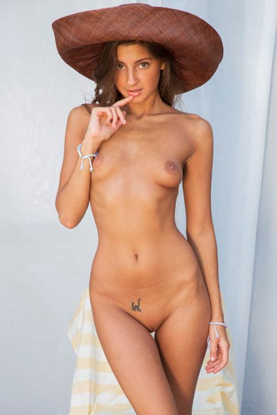 Sultry Angel with beautiful tanned body shows off her peachy ass