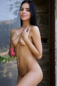 Venice Lei gorgeous dark haired doll posing naked in the garden