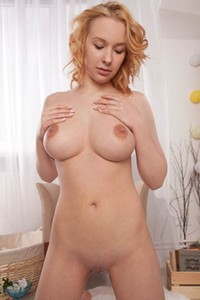 Blonde goddess Agatha shows her perfect boobs and shaved pussy